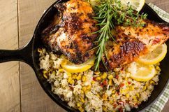 Lemon chicken with rice and roasted corn Stock Photo