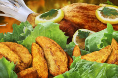 Lemon Chicken With Roasted Potato Slices And Lettu Royalty Free Stock Images