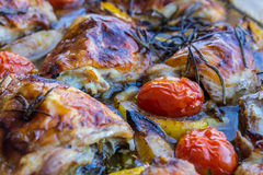 Lemon chicken with rosemary and cherry tomatoes Stock Images