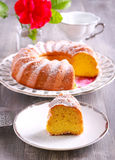 Lemon Chiffon Cake with icing sugar on top. Sliced royalty free stock images
