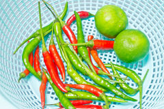 Lemon and chili in plastic basket, food ingredient Royalty Free Stock Images