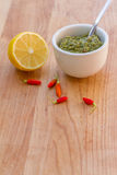 Lemon, chilli pepper and source on wooden cutting board, cooking Royalty Free Stock Photo