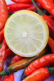 Lemon and chillies Royalty Free Stock Images