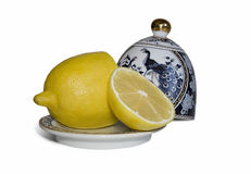 Lemon and china dishes Royalty Free Stock Photography