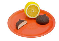 Lemon and chocolate cookie on plate Royalty Free Stock Photos