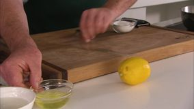 Lemon and chopping board. A medium shot of a lemon and a chopping board stock footage