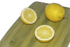Lemon on a chopping board Royalty Free Stock Photography