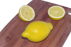 Lemon on a chopping board Stock Images
