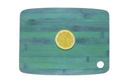 Lemon on a chopping board Stock Image