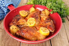 Lemon Cilantro chicken. Roasted free range organic Chicken dinner with potatoes, carrots, lemon and cilantro stock image