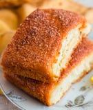 Lemon cinnamon buns on a white plate,breakfast Royalty Free Stock Photography