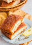 Lemon cinnamon buns on a white plate,breakfast Stock Images