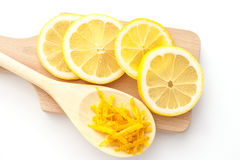 Lemon circles and lemon zest. Lemon zest and sliced lemons on a cutting boards, ingredients for a dessert Royalty Free Stock Photo