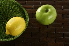 Lemon citric fruit and Green apple. Yellow lemon a healthy C Vitamin citric fruit with one green apple royalty free stock photography