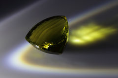 Lemon Citrine. Close-faceted citrine lemon-colored triangular shape Stock Image