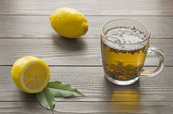 Lemon citrus fruit with cup of black tea Royalty Free Stock Photography