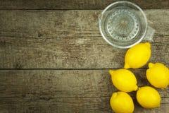 Lemon, citrus fruit. Fresh and juicy lemons on old wooden table. Tropical fruit full of vitamin C. Stock Image