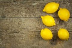 Lemon, citrus fruit. Fresh and juicy lemons on old wooden table. Tropical fruit full of vitamin C. Royalty Free Stock Images