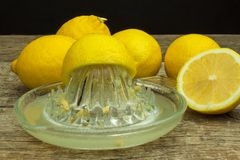 Lemon, citrus fruit. Fresh and juicy lemons on old wooden table. Tropical fruit full of vitamin C. Royalty Free Stock Photos