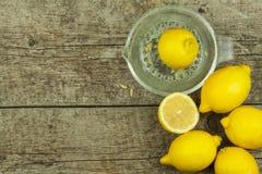Lemon, citrus fruit. Fresh and juicy lemons on old wooden table. Tropical fruit full of vitamin C. Stock Photography