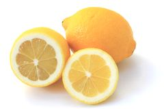 Lemon (Citrus x limon). Ripe fruits, partly piece cut and  isolated in front of white background Stock Photos