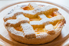 Lemon citrus tart dessert on wooden plate Royalty Free Stock Photo