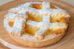 Lemon citrus tart dessert on wooden plate Royalty Free Stock Photography
