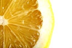 Lemon Closeup. Macro Shot Of Slice of Lemon on White Isolated Background Royalty Free Stock Photography