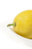 Lemon Closeup on White Plate Stock Photo