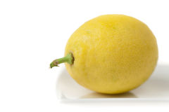 Lemon Closeup on White Plate Royalty Free Stock Images