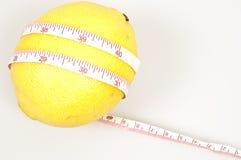Lemon and cm ruler. Isolated lemon and cm ruler stock image