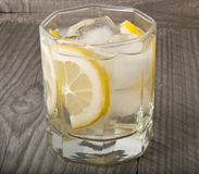 Lemon Cocktail. On a wooden background Royalty Free Stock Photo