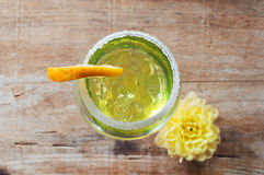 Lemon cocktail in a glass on wooden background Stock Photos