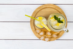 Lemon cocktail with ice and segments of a lemon Stock Images