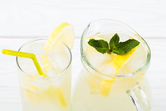 Lemon cocktail with ice and segments of a lemon Stock Photo