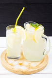 Lemon cocktail with ice and segments of a lemon Royalty Free Stock Photo