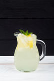 Lemon cocktail with ice and segments of a lemon Royalty Free Stock Photos