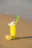 Lemon cocktail on the sand Stock Images