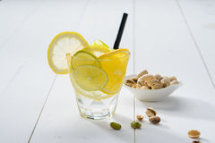 Lemon cocktail with straw Stock Photo