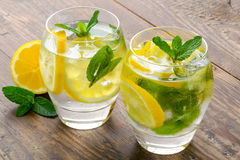 Lemon coctail drink. Lemonade in two glass and royalty free stock photo