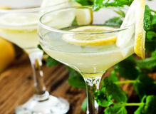 Lemon Coctails. Lemon Coctail Glasses with Lemon Slices and Mint Royalty Free Stock Photography