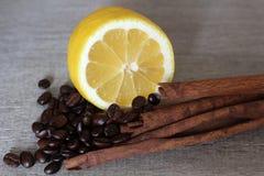 Lemon, coffee beans and cinnamon Royalty Free Stock Photos