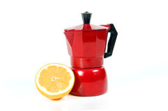 Lemon with coffee maker. Coffee maker with sliced lemon on a white background Stock Photography