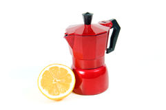 Lemon with coffee maker. Coffee maker with sliced lemon on a white background Royalty Free Stock Images