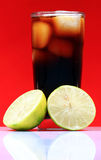Lemon and cola drink Royalty Free Stock Images