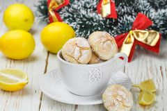 Lemon cookie with powdered sugar in a white Cup Stock Image
