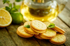 Lemon cookies with tea and mint Royalty Free Stock Photo