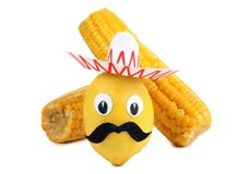 Lemon and corn one. Lemon and corn in the form of Mexican toys on a white background Stock Photography