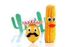 Lemon and corn three. Lemon and corn in the form of Mexican toys on a white background Stock Images