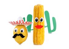 Lemon and corn two. Lemon and corn in the form of Mexican toys on a white background Stock Photo